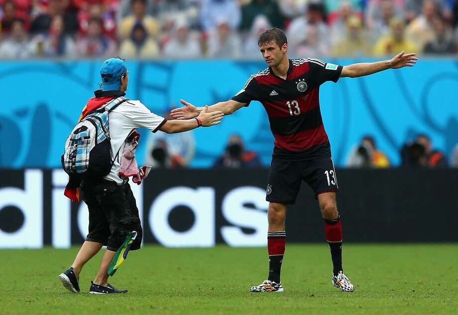 A pitch invader interacts with Thomas Mueller of Germany during the 2014 FIFA World Cup Brazil group G match between the United States and Germany at Arena Pernambuco on June 26, 2014 in Recife, Brazil. Photo: Michael Steele, Getty Images