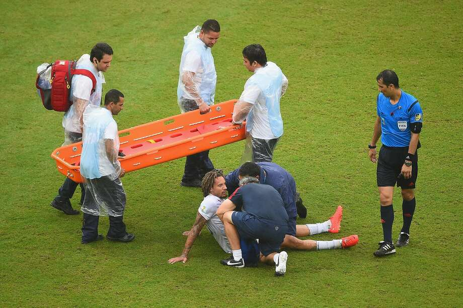Jermaine Jones of the United States receives treatment after a collision during the 2014 FIFA World Cup Brazil group G match between the United States and Germany at Arena Pernambuco on June 26, 2014 in Recife, Brazil. Photo: Laurence Griffiths, Getty Images