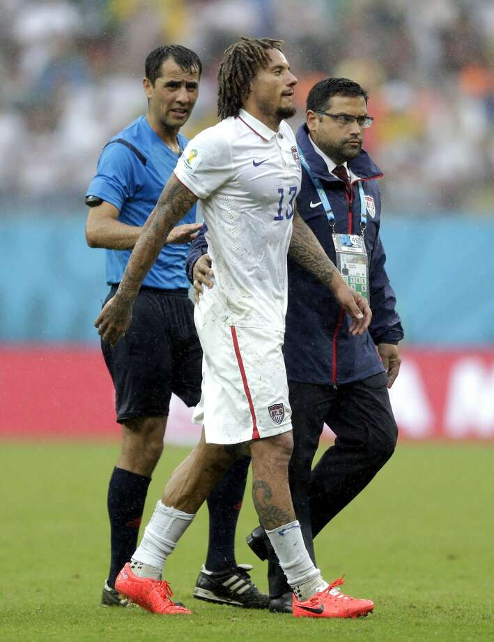 Referee Ravshan Irmatov from Uzbekistan watches as United States' Jermaine Jones walks off the pitch after colliding with his teammates Alejandro Bedoya during the group G World Cup soccer match between the United States and Germany at the Arena Pernambuco in Recife, Brazil, Thursday, June 26, 2014.  Photo: Julio Cortez, Associated Press