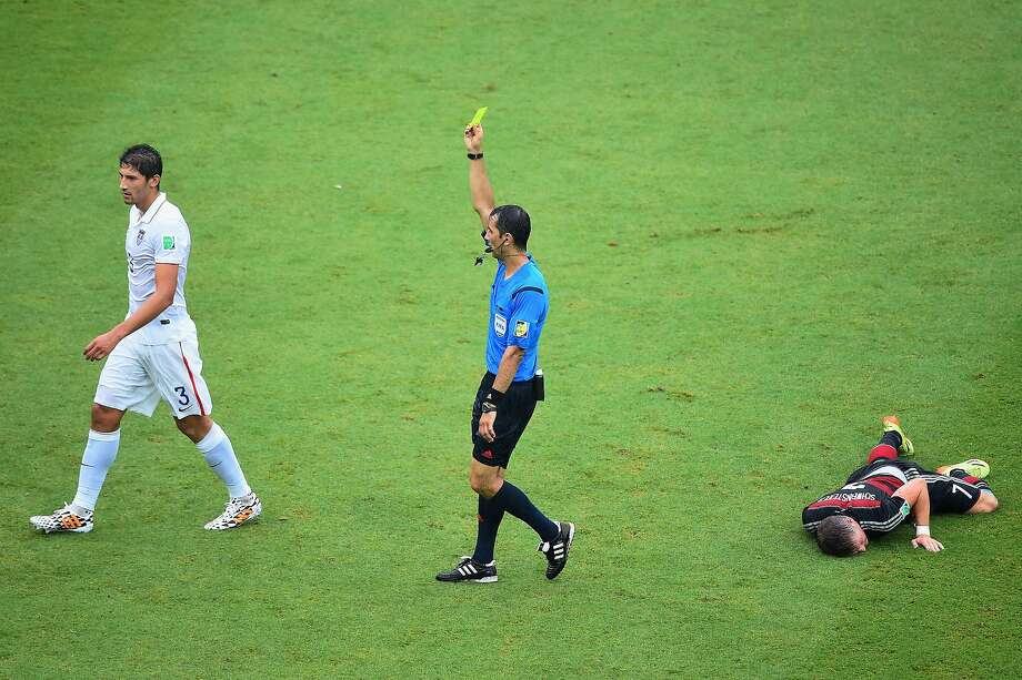 Omar Gonzalez of the United States is shown a yellow card by referee Ravshan Irmatov after a foul on Bastian Schweinsteiger of Germany during the 2014 FIFA World Cup Brazil group G match between the United States and Germany at Arena Pernambuco on June 26, 2014 in Recife, Brazil. Photo: Laurence Griffiths, Getty Images