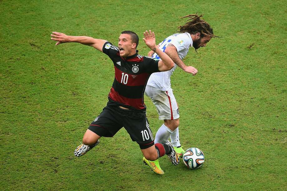Lukas Podolski of Germany is challenged by Kyle Beckerman of the United States during the 2014 FIFA World Cup Brazil group G match between the United States and Germany at Arena Pernambuco on June 26, 2014 in Recife, Brazil.  Photo: Laurence Griffiths, Getty Images