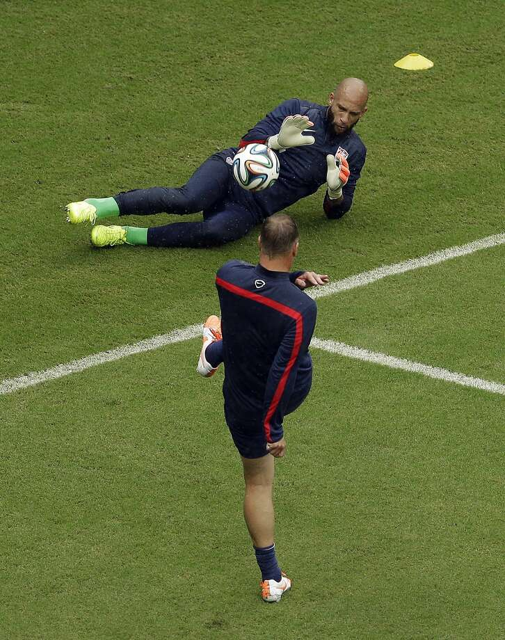 United States' goalkeeper Tim Howard gets warmed up before the group G World Cup soccer match between the USA and Germany at the Arena Pernambuco in Recife, Brazil, Thursday, June 26, 2014. Photo: Hassan Ammar, Associated Press