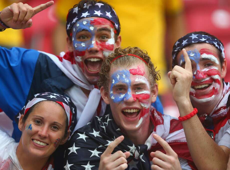 United States fans cheer in the rain prior to the 2014 FIFA World Cup Brazil group G match between the United States and Germany at Arena Pernambuco on June 26, 2014 in Recife, Brazil.  Photo: Martin Rose, Getty Images