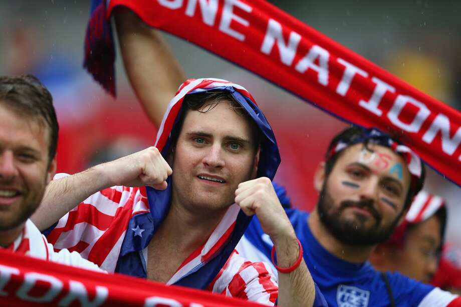 United States fans look on in the rain prior to the 2014 FIFA World Cup Brazil group G match between the United States and Germany at Arena Pernambuco on June 26, 2014 in Recife, Brazil. Photo: Michael Steele, Getty Images