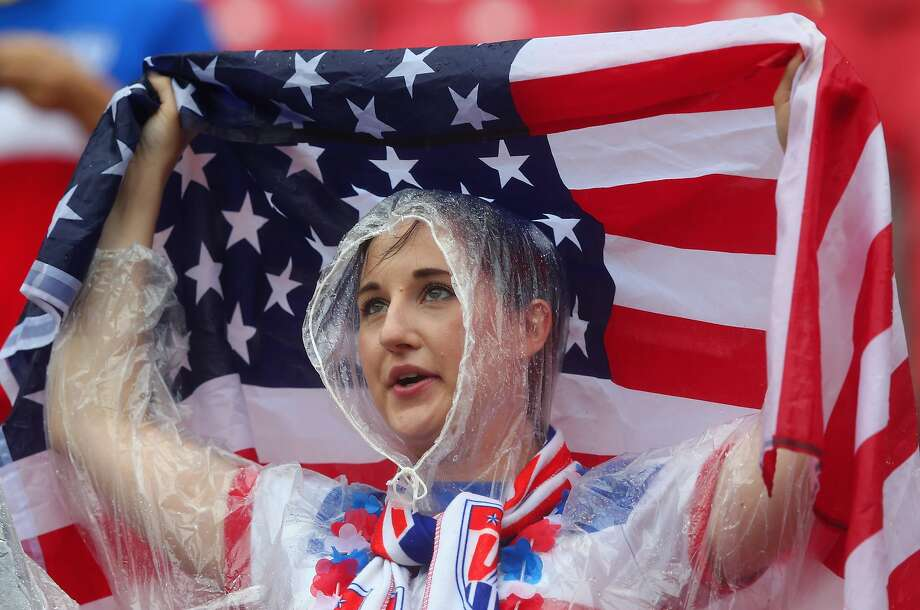 An United States fan looks on in the rain prior to the 2014 FIFA World Cup Brazil group G match between the United States and Germany at Arena Pernambuco on June 26, 2014 in Recife, Brazil.  Photo: Martin Rose, Getty Images