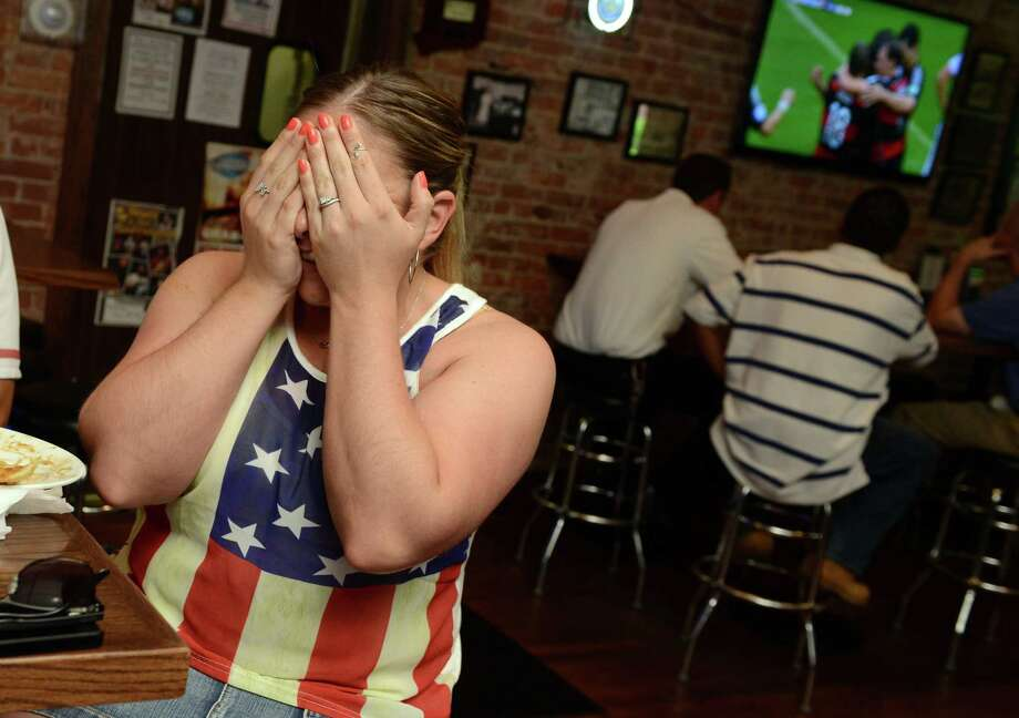 Beth Maldonado, of Stratford, reacts to Germany's goal during the World Cup match against the United States Thursday, June 26, 2014, while she was watching the game with coworkers at Windmill Tavern in Stratford, Conn. Photo: Autumn Driscoll / Connecticut Post
