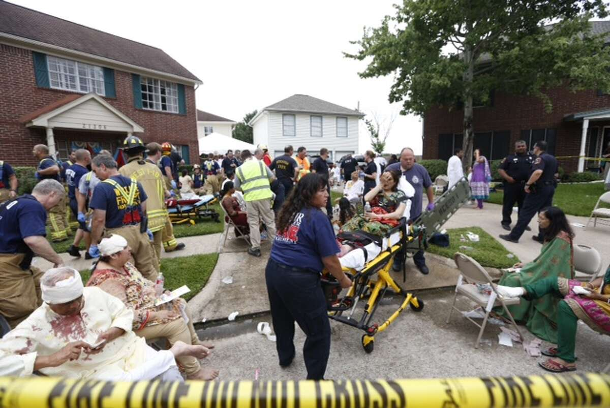 Rescuers Thursday afternoon rushed to a residential area in west Harris County after a garage reportedly collapsed, sending dozens to the hospital.