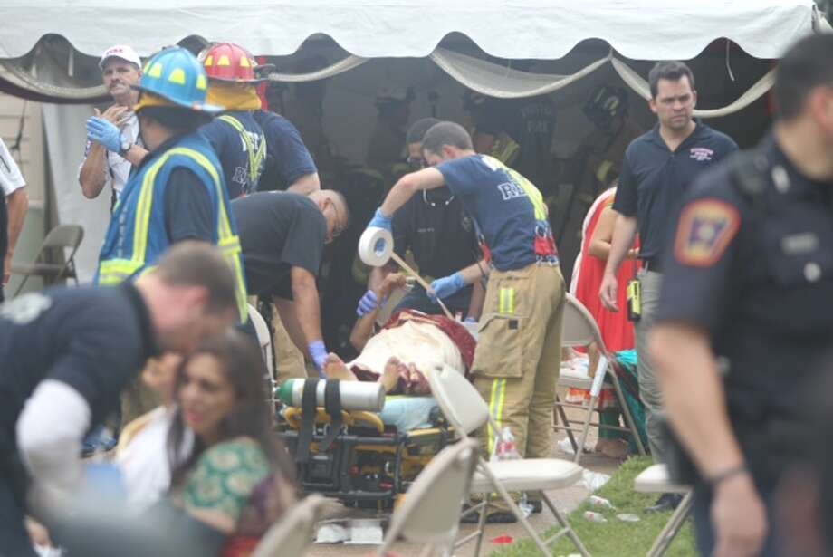 Rescuers Thursday afternoon rushed to a residential area in west Harris County after a garage reportedly collapsed, sending dozens to the hospital. Photo: Cody Duty, Houston Chronicle
