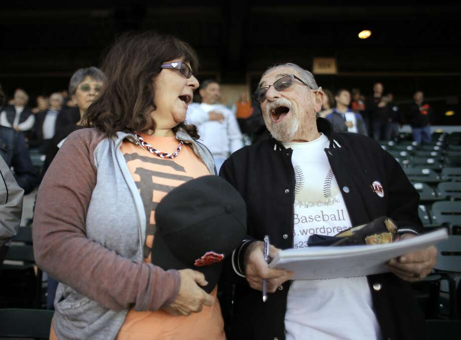 Bert and Le Anne Steinberg sing the national anthem along with the crowd at the Giants game against the San Diego Padres at AT&T Park in San Francisco, Calif. Bert and Le Anne Steinberg are San Francisco Giants fans who are traveling to all 81 road games this year. Photo: Carlos Avila Gonzalez, The Chronicle