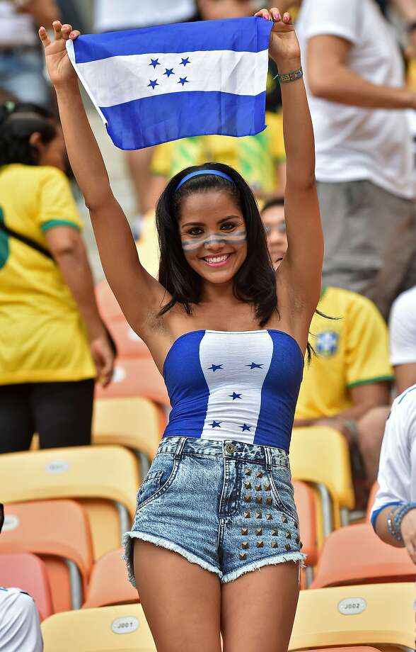 Honduran knockout: A Honduras fan cheers for her team before the Honduras-Switzerland match in Manaus, Brazil. 