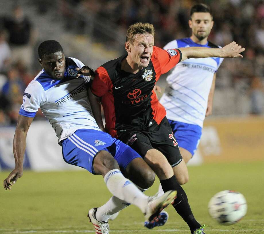 San Antonio Scorpions' Tomasz Zahorski (center)  tangles with Edmonton's Kareem Moses. An MLS deal is being discussed for San Antonio, and city involvement is being sought. Photo: Courtesy Photo / Darren Abate/DA Media, LLC