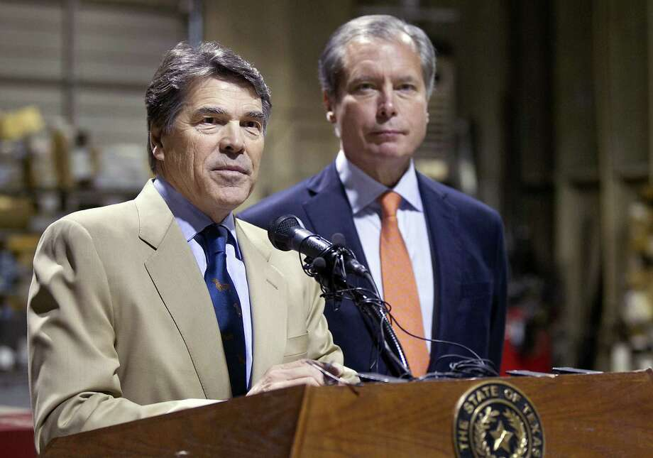 Gov. Rick Perry and Lt. Gov. David Dewhurst should take the lead in launching a cooperative effort with Mexico and the U.S. government to address immigration woes on the border. Photo: Laura Skelding / Associated Press / Statesman.com