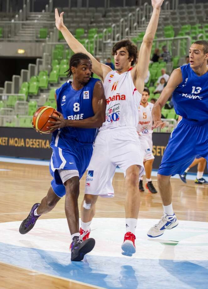 Livio Jean-Charles (left), the Spurs' 2013 draft pick at No. 28, missed the entire season with ASVEL Basket in France while recovering from a knee injury suffered while competing for France's U-20 national team. But he won't turn 21 until November, giving him more than enough time to recover and build on the potential. Photo: Jure Makovec, AFP/Getty Images