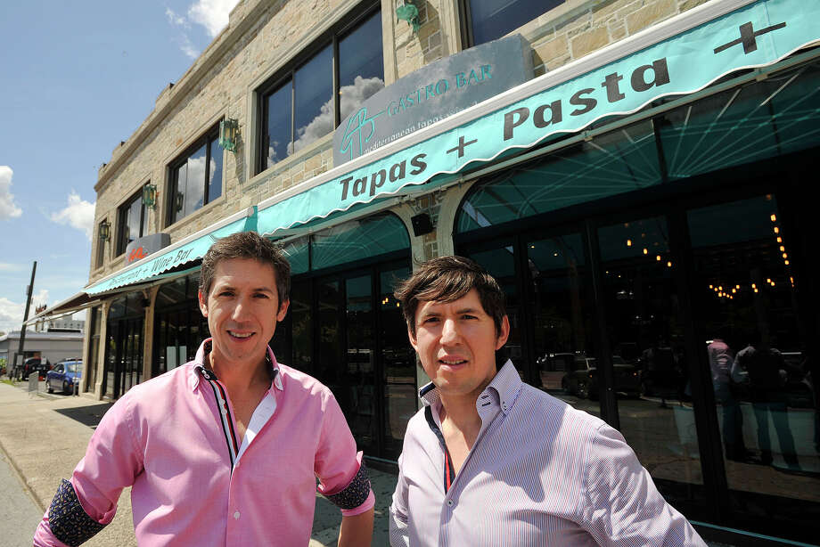 Brothers and business partners Mario Lopez, left, and Alejandro Lopez pose in front of their two new Columbus Park restaurants, Azuca, at left, and Gastro Bar in Stamford, Conn., on Thursday, June 26, 2014. Photo: Jason Rearick / Stamford Advocate