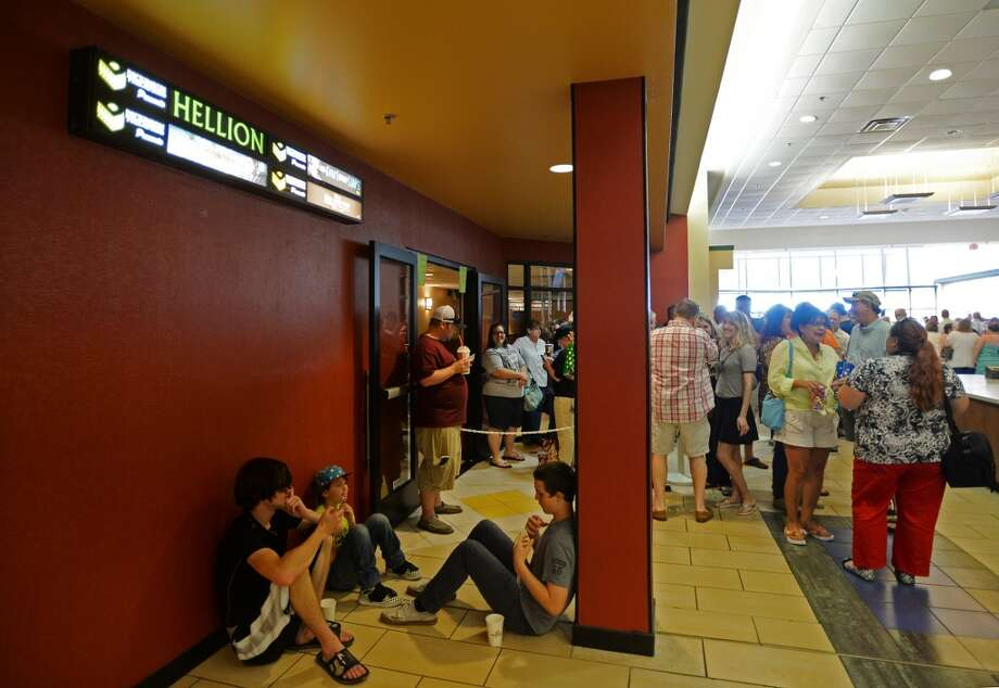 "Seth Summers, 17, Blake Hancock, 11, and Dylan Faircloth, 14, left to right, take a seat as they and others wait for the showings of ""Hellion"" at Central Mall 10 on Tuesday. The Central Mall 10 cinema in Port Arthur hosted two showings of the movie ""Hellion"" on Tuesday evening. Writer and director Kat Candler, producer Kelly Williams, and other crew and cast members attended the premiere of the locally shot film. Photo taken Tuesday 6/10/14 Jake Daniels/@JakeD_in_SETX"