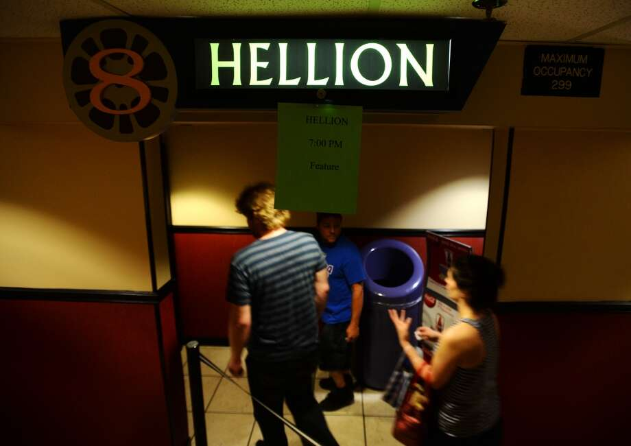"People head into a theater at Central Mall 10 for a showing of ""Hellion"" on Tuesday. The Central Mall 10 cinema in Port Arthur hosted two showings of the movie ""Hellion"" on Tuesday evening. Writer and director Kat Candler, producer Kelly Williams, and other crew and cast members attended the premiere of the locally shot film. Photo taken Tuesday 6/10/14 Jake Daniels/@JakeD_in_SETX"