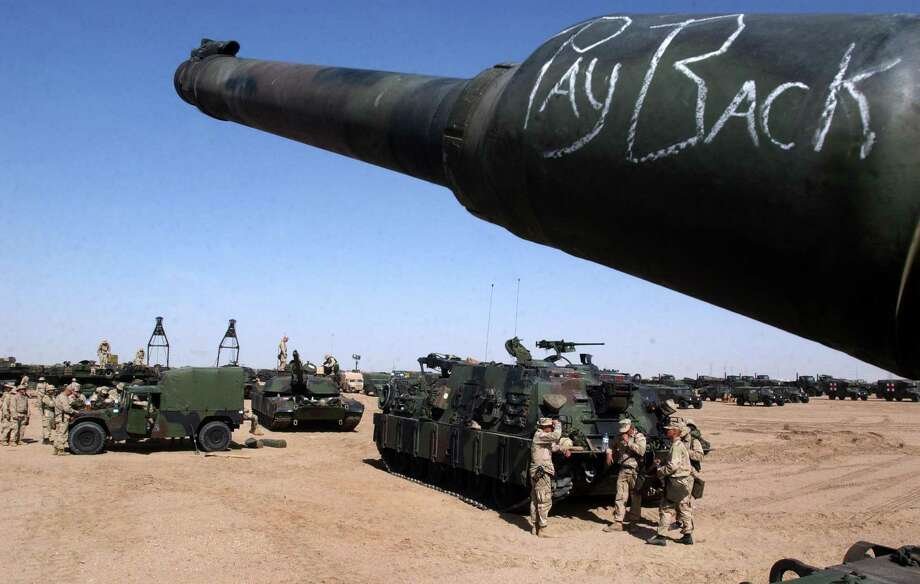 In February 2003, a handwritten message adorns a  Marine M1A1 Abrams tank as preparations get underway for action in Iraq. More than a decade later, we've not learned the lessons of  involvement in the Mideast. Photo: Getty Images File Photo / 2003 Getty Images