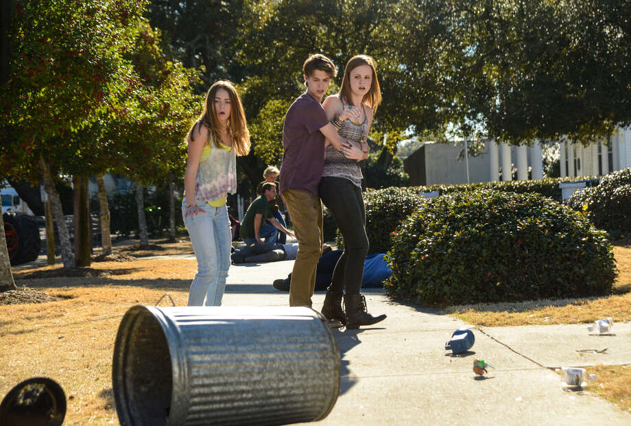 Young Chester's Mill residents (Britt Robertson, Colin Ford and Mackenzie Lintz-Hill) try to avoid flying metal objects when the dome becomes magnetized in season two of the CBS thriller. Novelist Stephen King has a cameo in Monday's season opener. Photo: CBS / �©2014 Broadcasting Inc. All Rights Reserved