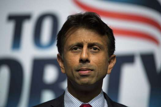 "Louisiana Gov. Bobby Jindal: ""The lawsuit against @GovernorPerry is a blatant misuse of the judicial system by liberal activists who couldn't defeat him at the polls,"" Jindal tweeted. ""@GovernorPerry exercised his constitutional authority and this circus is simply a political witch-hunt. I stand behind @GovernorPerry in his fight for honest government and I am certain he will prevail in this partisan suit.""Pictured, Louisiana Gov. Bobby Jindal delivers the keynote address during Faith and Freedom Coalition's Road to Majority event in Washington, Saturday, June 21, 2014.   (AP Photo/Molly Riley) Photo: Molly Riley, Associated Press / FR170882 AP"