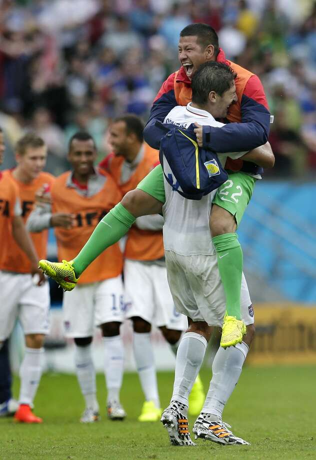 United States' goalkeeper Nick Rimando, right, celebrates with Omar Gonzalez after advancing to the round of 16 despite a 0-1 loss to Germany after the group G World Cup soccer match between the USA and Germany at the Arena Pernambuco in Recife, Brazil, Thursday, June 26, 2014. (AP Photo/Petr David Josek) Photo: Petr David Josek, Associated Press