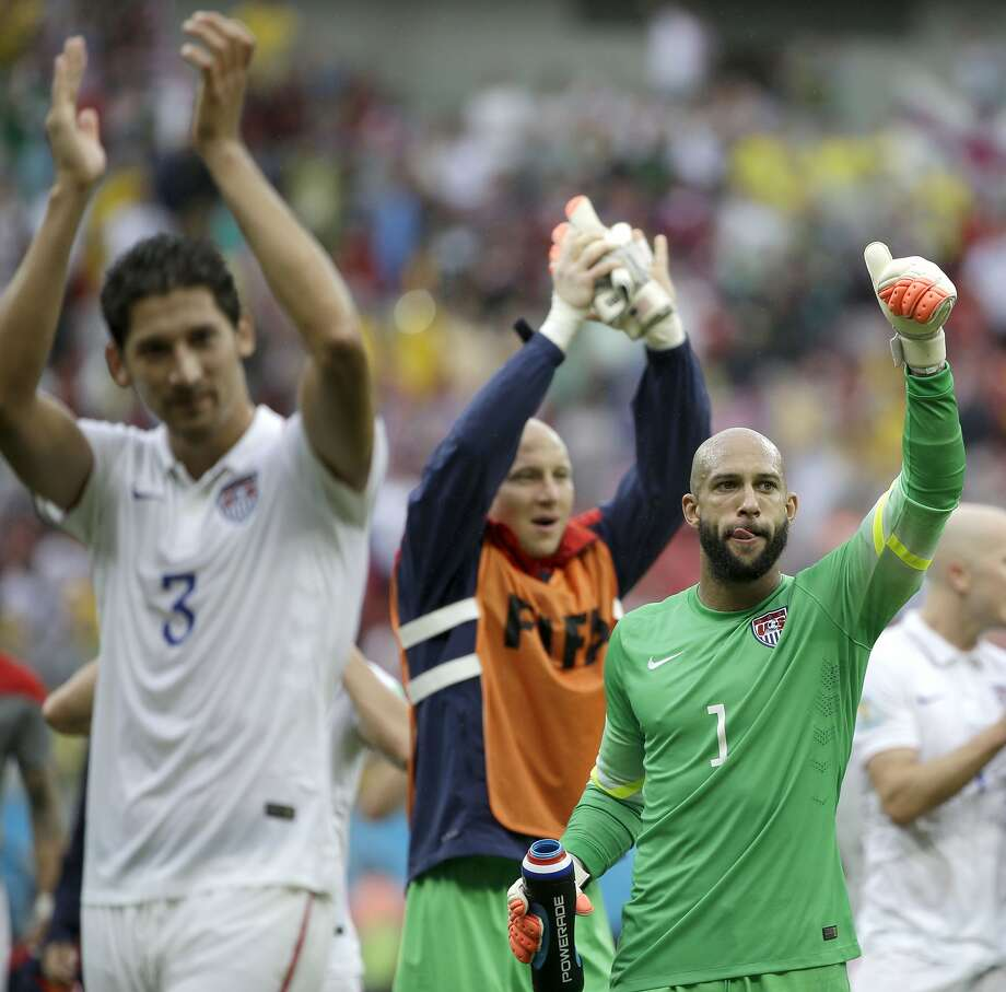 Defender Omar Gonzalez (No. 3) and goalkeeper Tim Howard (No. 1) celebrate the U.S. team advancing in rainy Recife. Photo: Ricardo Mazalan, Associated Press