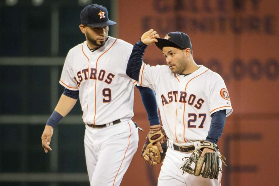 Astros second baseman Jose Altuve (27) and shortstop Marwin Gonzalez (9) leave the field after a victory. Photo: Smiley N. Pool, Houston Chronicle