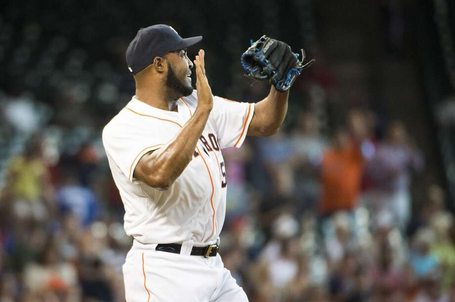 Astros relief pitcher Jose Veras celebrates after recording the final out. Photo: Smiley N. Pool, Houston Chronicle