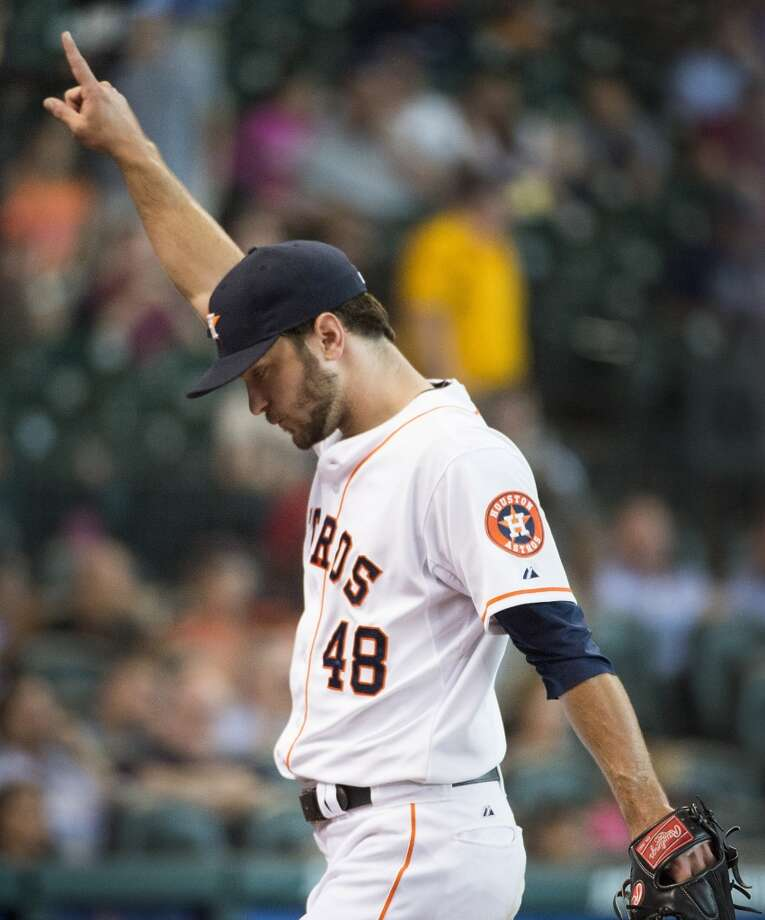 Astros starting pitcher Jarred Cosart points to the crowd as he leaves the field after the seventh inning. Photo: Smiley N. Pool, Houston Chronicle