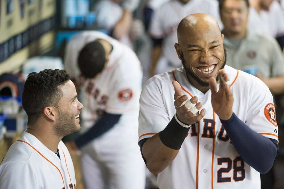 Astros first baseman Jon Singleton (28) laughs with second baseman Jose Altuve in the dugout during the fifth inning. Photo: Smiley N. Pool, Houston Chronicle