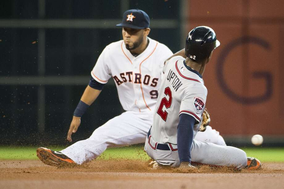 Braves center fielder B.J. Upton (2) is safe at second base with a stolen base as the ball gets away from Astros shortstop Marwin Gonzalez (9) during the first inning. Photo: Smiley N. Pool, Houston Chronicle