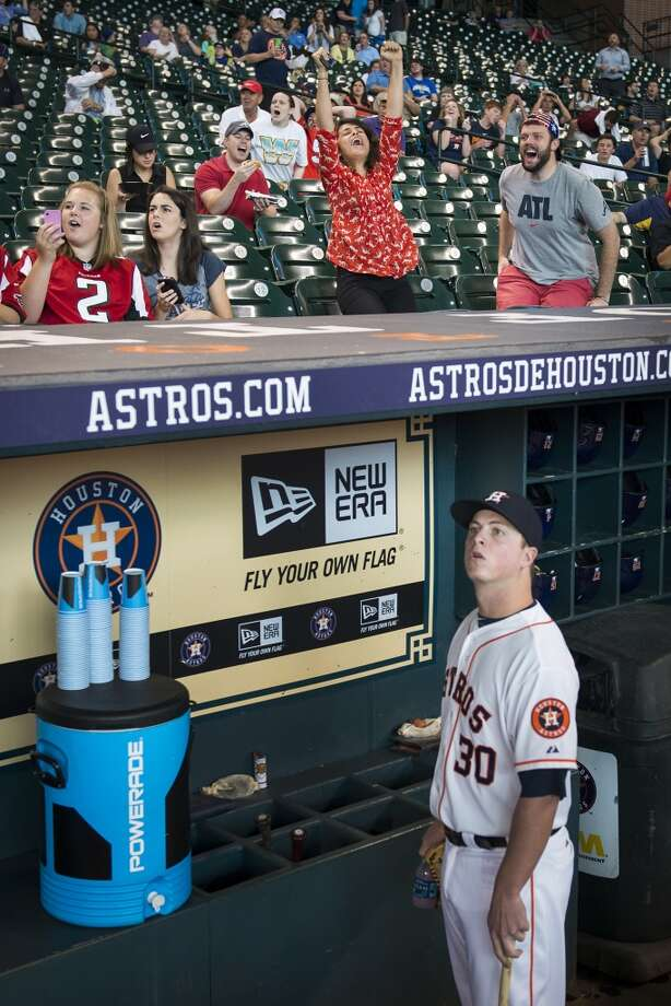 Astros third baseman Matt Dominguez watches from the dugout as fans at Minute Maid Park react while watching the USA play Germany in World Cup soccer action before the Astros game. Photo: Smiley N. Pool, Houston Chronicle