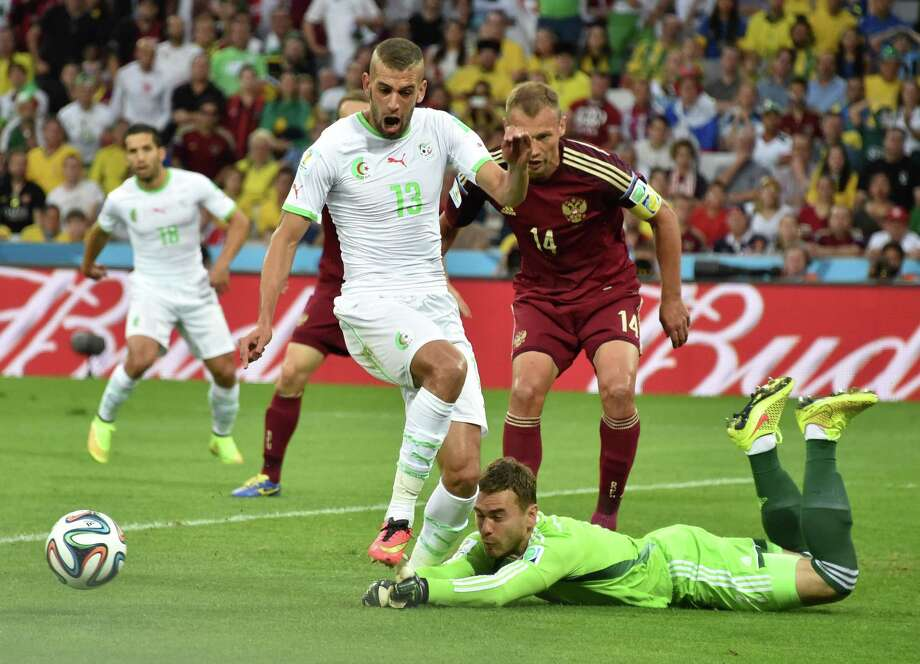 June 26  Algeria 1, Russia 1 Photo: KIRILL KUDRYAVTSEV, AFP/Getty Images / AFP