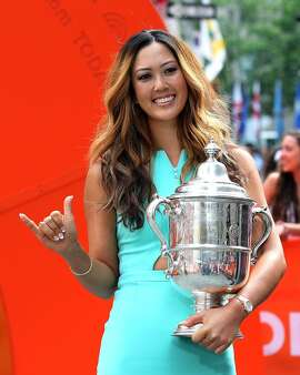 NEW YORK, NY - JUNE 24: Michelle Wie winner of the U.S. Women's Open gestures while appearing on NBC's the 'Today Show' during her Media Tour June 24, 2014 in New York City. (Photo by Adam Hunger/Getty Images)