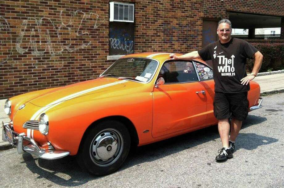 Bill Geller of Purdys, N.Y., who was killed in a traffic accident last year, with his restored 1967 Volkswagen Karmann Ghia. GellerâÄôs sisters have organized a classic car show in his memory that will be held at Temple Beth Elohim  in Brewster on Sunday. Photo: Contributed Photo / The News-Times Contributed