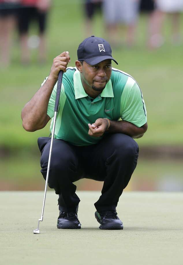 Tiger Woods, evaluating a first-round putt on No. 6, is playing in his first PGA tournament in more than three months. Photo: Patrick Semansky, Associated Press