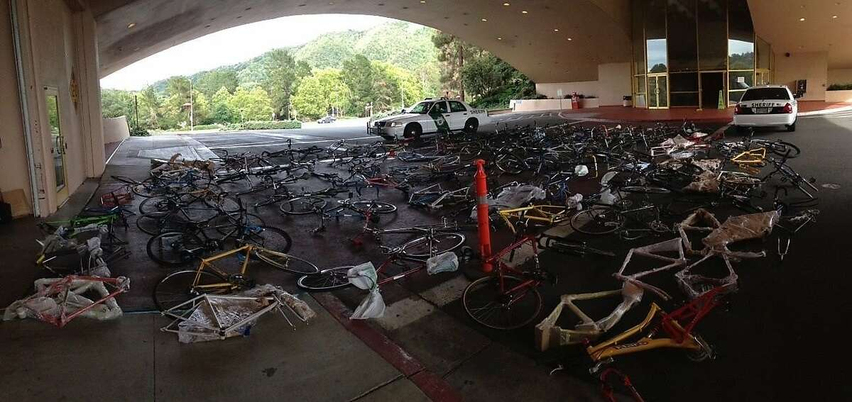 Investigators sort through the 133 suspected stolen bicycle and bicycle frames recovered in three raids around Marin County on June 24, 2014.