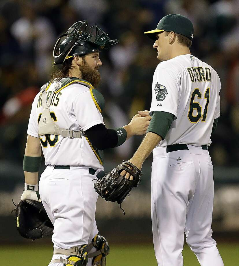 Dan Otero is congratulated by catcher Derek Norris after wrapping up his first career save against Boston on June 19. Photo: Ben Margot, Associated Press