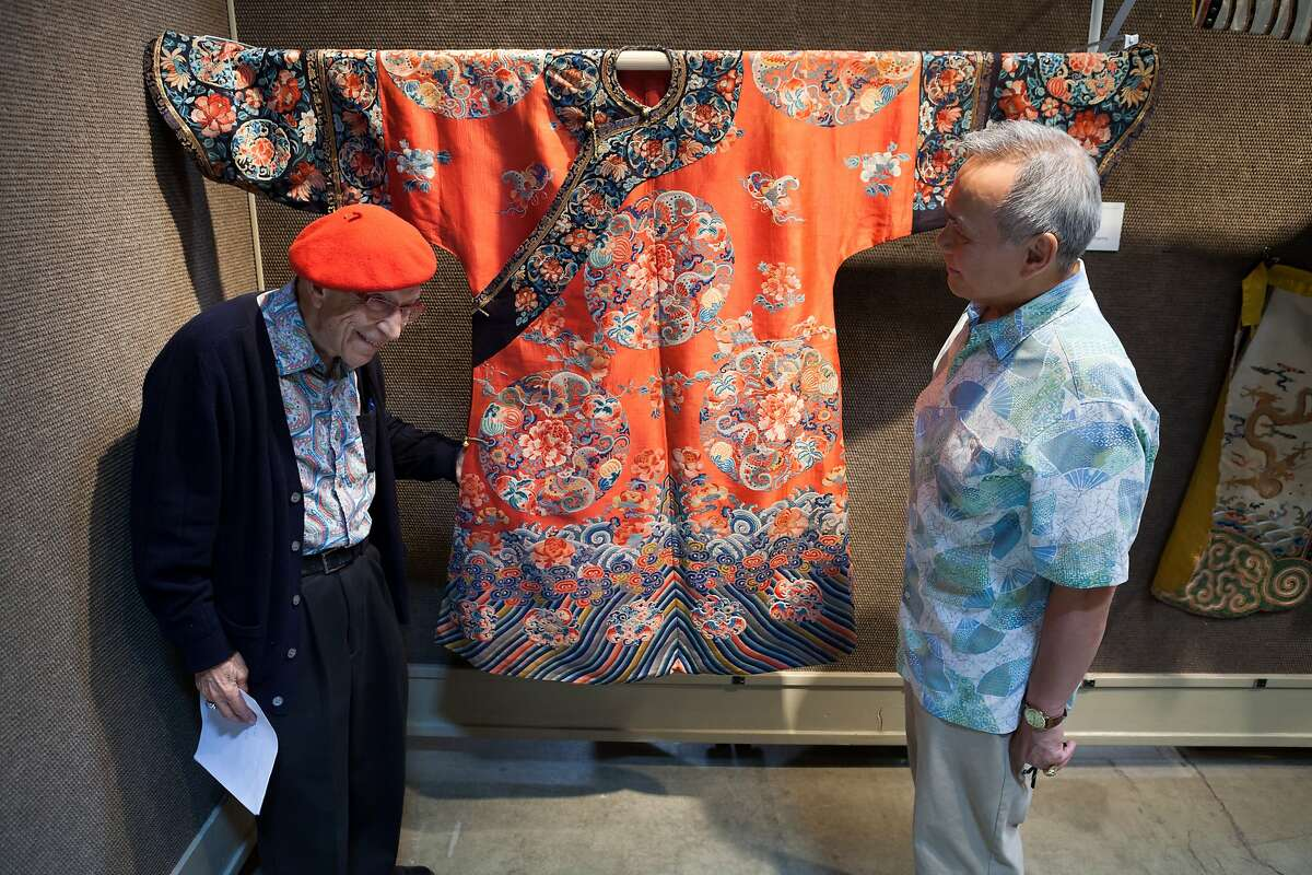Collectors Lee Kavaljian and Stanley Fong examine Asian Decorative Art at Bonhams Lts. in San Francisco, CA. This Manchu noblewoman's robe is valued at $5000 to $7000 by Bonhams. Photographed on June 22, 2014 in the San Francisco, CA design district.