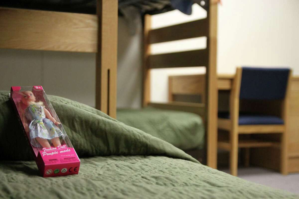 A doll rests awaits its new owner in the barracks for law enforcement trainees that has been turned into immigrant detention center at the Federal Law Enforcement Center in Artesia, N.M.