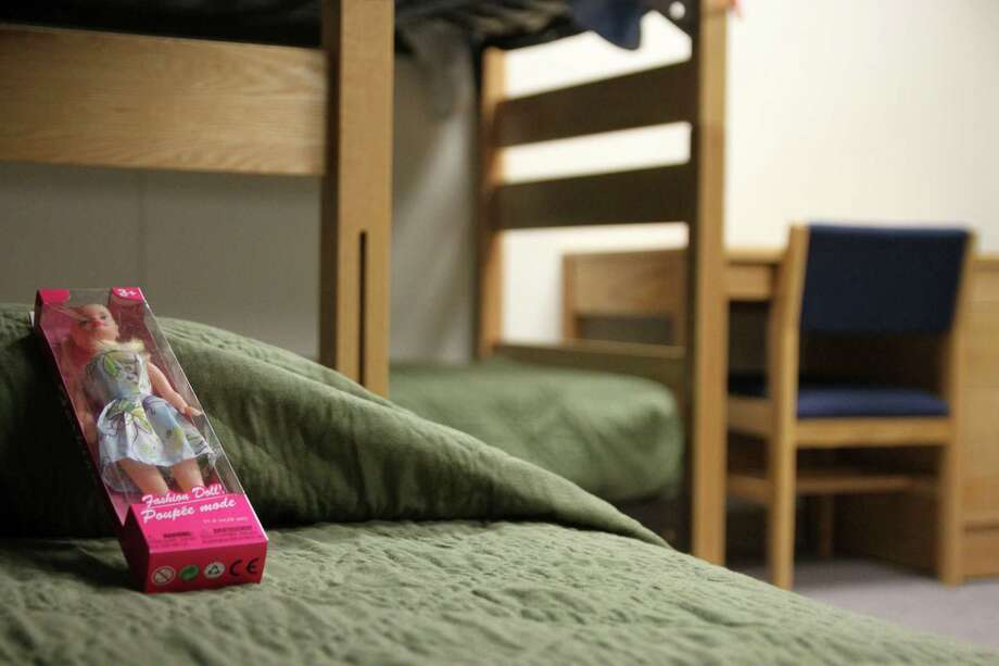 A doll rests awaits its new owner in the barracks for law enforcement trainees that has been turned into immigrant detention center at the Federal Law Enforcement Center in Artesia, N.M. Photo: Juan Carlos Llorca, STF / AP