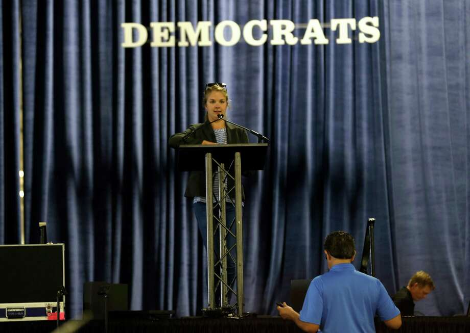 The main stage podium is checked during set up at the Dallas Convention Center in preparation for the Texas Democratic Convention in Dallas on Thursday. Photo: LM Otero, STF / AP
