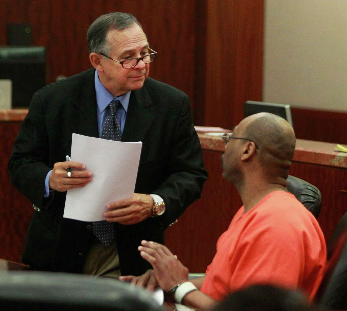 Defense attorney Gerald Bourque, left, says he has clients whose cases have been affected by revelations of possible crime lab misconduct, including Larry Lee Lewis, right, who is accused of capital murder.