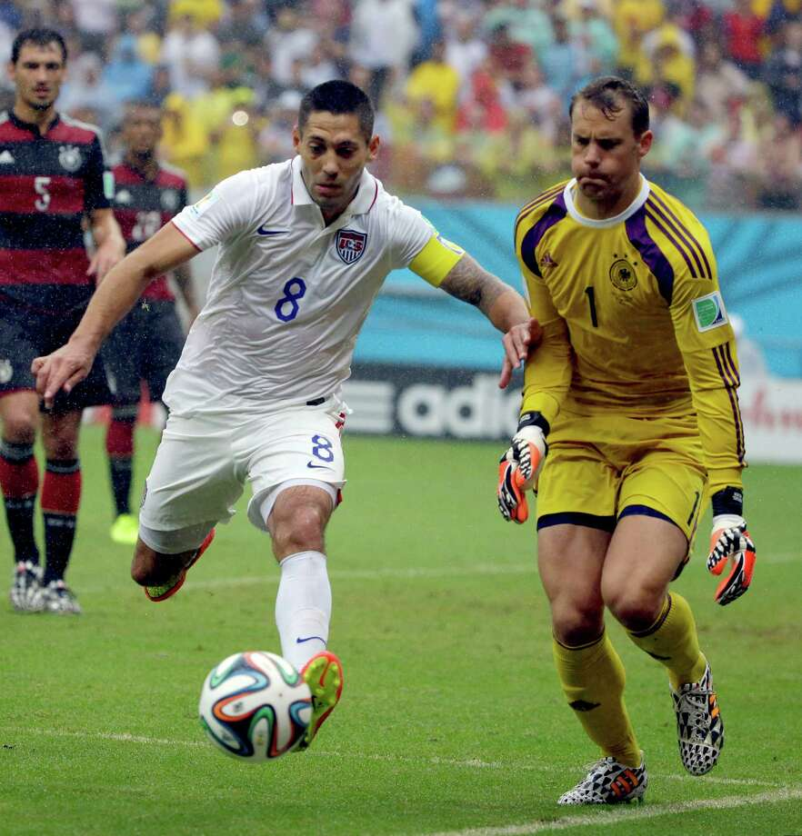 United States' Clint Dempsey chases the ball in front of Germany's goalkeeper Manuel Neuer during the group G World Cup soccer match between the USA and Germany at the Arena Pernambuco in Recife, Brazil, Thursday, June 26, 2014. (AP Photo/Ricardo Mazalan) ORG XMIT: WCDP157 Photo: Ricardo Mazalan / AP