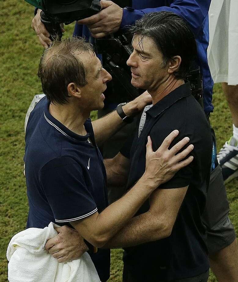 Jurgen Klinsmann (left) greets Germany's coach, Joachim Loew, at match's end. Photo: Hassan Ammar, Associated Press
