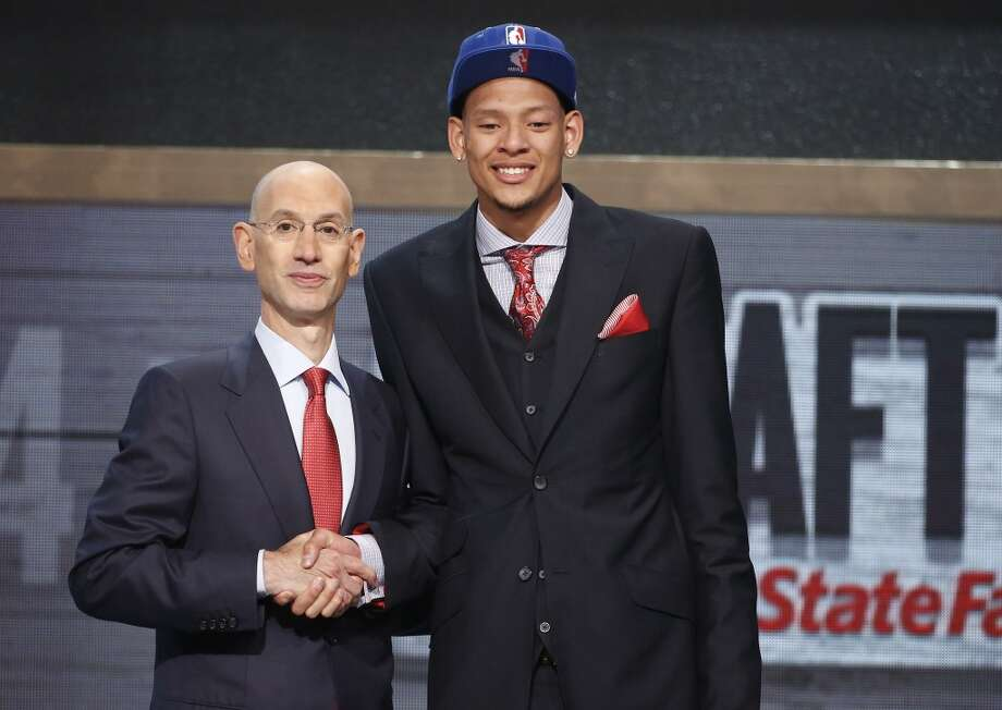 Baylor center Isaiah Austin, right, poses for a photo with NBA Commissioner Adam Silver after being granted ceremonial first-round pick.  Austin's career in competitive basketball ended suddenly last week when he was diagnosed with Marfan syndrome, an inherited disorder that affects the heart, eyes, skeleton, and circulatory center, according to the Mayo Clinic's website. Photo: Jason DeCrow, Associated Press
