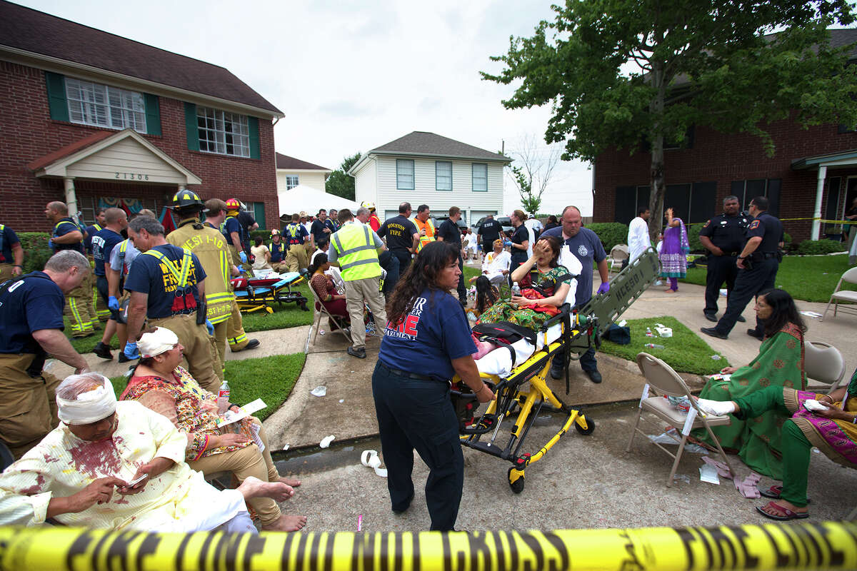 About 150 people had gathered at the home on Park Mill Drive in Katy Thursday, where a room over the garage, rear, collapsed under the weight of 40 people, injuring at least three dozen. Emergency workers tended to scores at the scene.