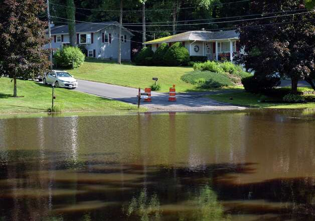 Flood waters from Wednesday's downpour New Castle Road Thursday, June 26, 2014, in Halfmoon, NY.  (John Carl D'Annibale / Times Union) Photo: John Carl D'Annibale / 00027522A