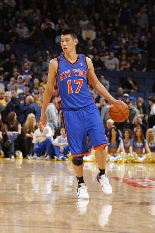 OAKLAND, CA - DECEMBER 28: Jeremy Lin #17 of the New York Knicks dribbles the ball up the court against the Golden State Warriors during a game at Oracle Arena on December 28, 2011 in Oakland, California. NOTE TO USER: User expressly acknowledges and agrees that, by downloading and or using this photograph, User is consenting to the terms and conditions of the Getty Images Agreement. Mandatory Copyright Notice: Copyright 2011 NBAE (Photo by Rocky Widner/NBAE via Getty Images) Photo: Rocky Widner, NBAE/Getty Images / 2011 NBAE