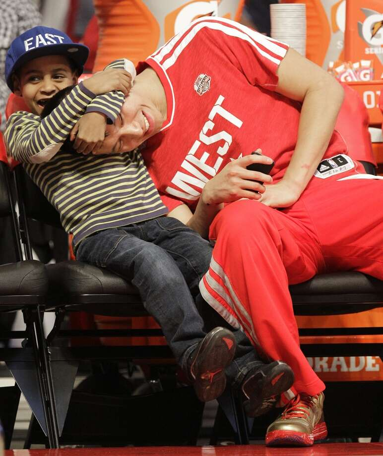 Jeremy Lin of the Houston Rockets plays with Kiyan Anthony, son of  Carmelo Anthony of the New York Knicks, after competing in the NBA All-Star Skills Challenge at the Toyota Center on All-Star Saturday Night, Saturday, Feb. 16, 2013, in Houston. ( Melissa Phillip / Houston Chronicle ) Photo: Melissa Phillip, Houston Chronicle