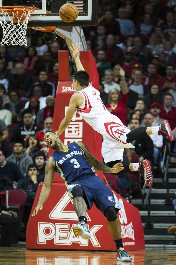 Houston Rockets point guard Jeremy Lin (7) shoots over Memphis Grizzlies power forward James Johnson (3) during the second half of an NBA basketball game at Toyota Center on Friday, Jan. 24, 2014, in Houston. The Grizzlies won the game 88-87. ( Smiley N. Pool / Houston Chronicle ) Photo: Smiley N. Pool, Houston Chronicle